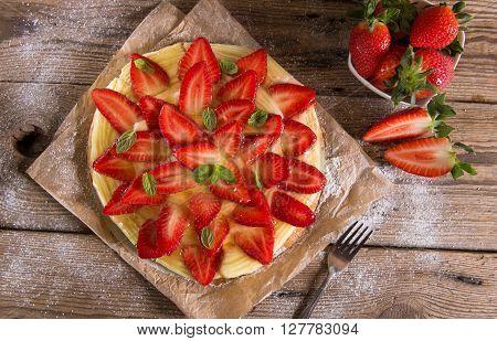 Homemade strawberry tart with cream and fresh strawberries