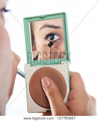 Reflection On Mirror Of Girl's Eye