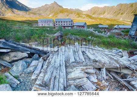 Sun-bleached wooden planks all that remain of a log cabin in a gold mine in the Alaska wilderness.