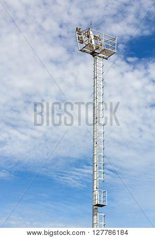 The Stadium Spot-light tower over Blue Sky