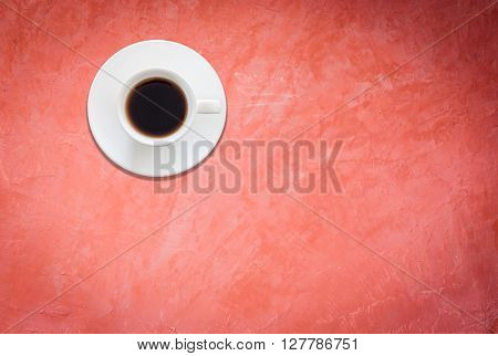 Top view of white coffee cup on red background, stock photo