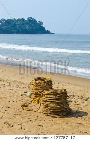 Rope on sand beach goa india near ocean