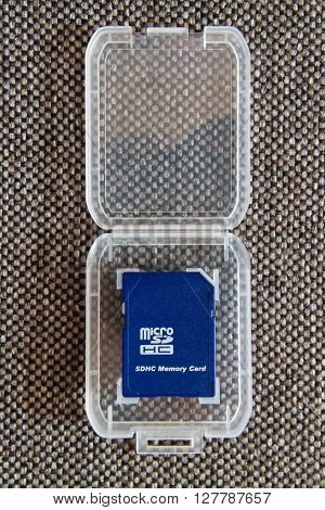 Blue Micro SD Card in Transparent Case at textile