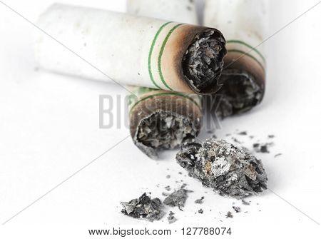 Cigarette stub three each isolate white background