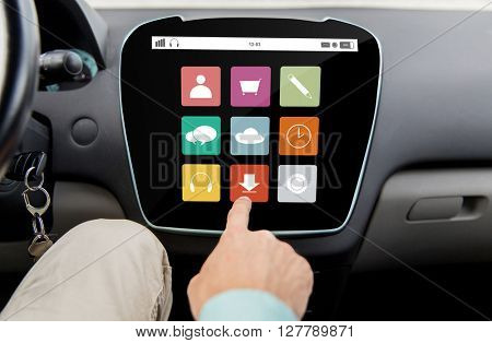 transport, driving, technology, media and people concept - close up of male hand with virtual applications icons on car computer screen