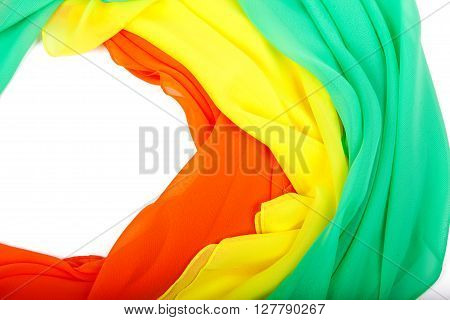Three female bright colored scarf on a white background