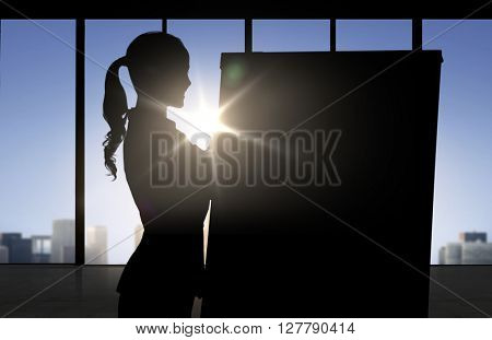 business, strategy, planning and people concept - silhouette of woman with flipboard over office window background and sunlight