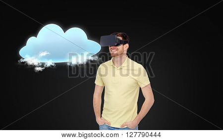3d technology, virtual reality, cloud computing, entertainment and people concept - happy young man in virtual reality headset or 3d glasses with cloud over black background