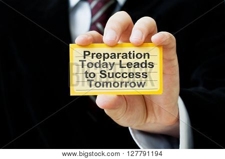 Preparation Today Leads to Success Tomorrow. Card in businessman hand