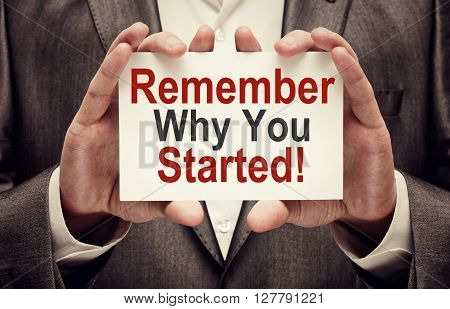 Remember Why You Started. Card in businessman hands