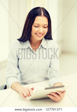office, business, education, technology and internet concept - smiling businesswoman or student with tablet pc