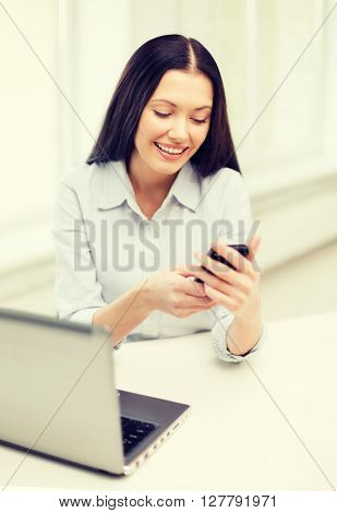 education, business and technology concept - smiling businesswoman or student with laptop computer and smartphone