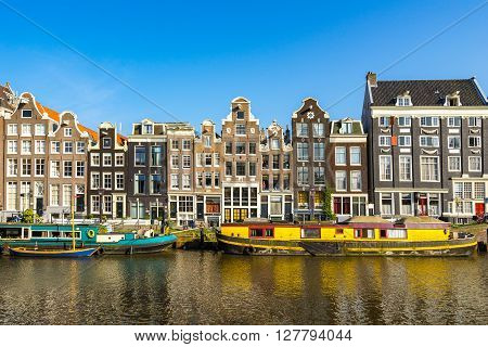 Canal houses by the Amstel river in Amsterdam City Center.