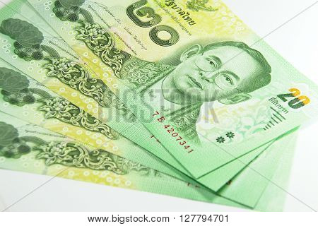 Closed up Thai banknote twenty baht isolated on white background