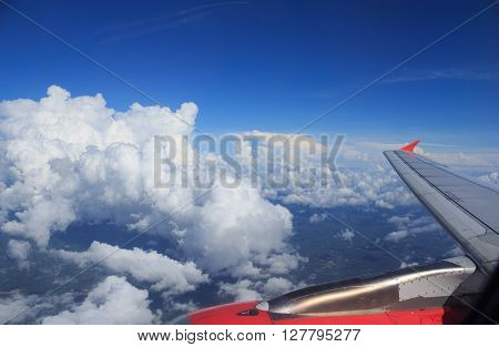 clear white cumulus cloud and cloudscape on blue skyhorizon background view from aircraft plane