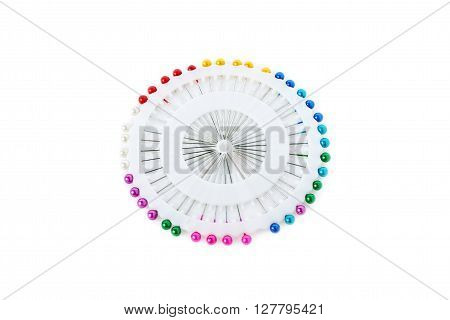 Set of colorful sewing push pins needles isolated over the white background