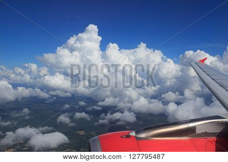 aerial top view from air plane flight high space with clear white cumulus cloud and cloudscape on blue sky
