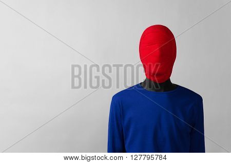 Surrealism Theme: Man In A Blue Jacket With A Red Cloth Tied Around His Head Is In The Corner On A G
