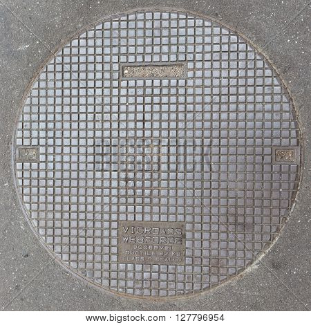 Melbourne - February 22 2016: Road metal hatch with the inscription: vicroads webforge in the asphalt on the streets February 22 2016 Melbourne Australia