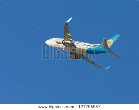 Moscow - August 20 2015: A passenger plane Boeing A319 airlines Ukraine International Airlines flies to Domodedovo airport and the blue sky August 20 2015 Moscow Russia