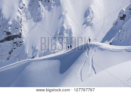Snowboard freeride, snowboarders and tracks on a mountain slope. Extreme winter sport.