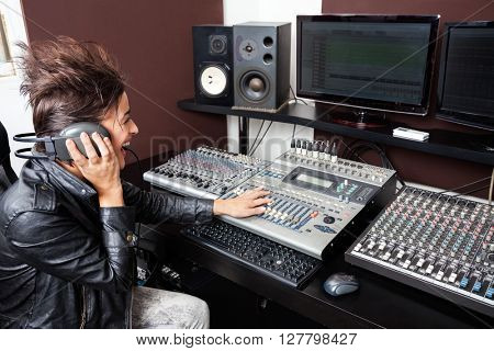 Woman Mixing Audio In Recording Studio