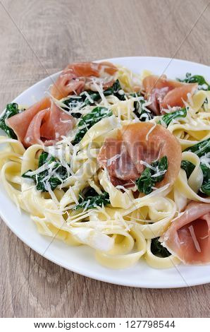 Pasta with spinach ham and parmesan cheese for milk sauce