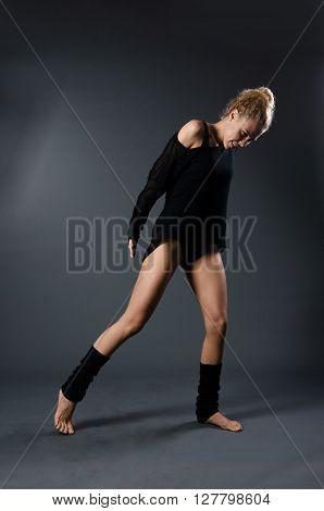 Modern Classical Dance Theme: Beautiful Girl Dancing Sensual Dance In A Studio On A Gray Background