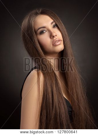 Dramatic Portrait Of A Girl Theme: Portrait Of A Young Beautiful Girl On A Dark Background In The St