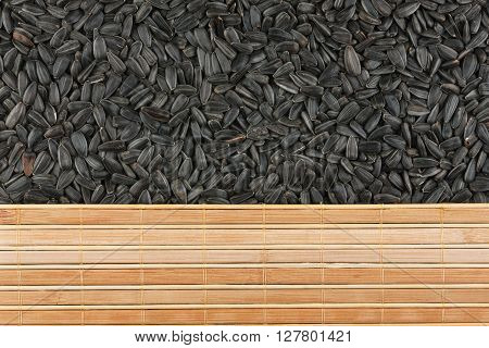 Sunflower seeds and bamboo mat with place for your text