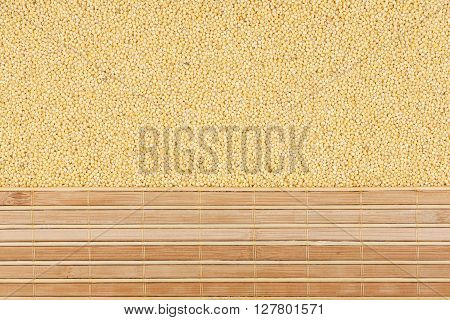 Millet grain and bamboo mat with place for your text
