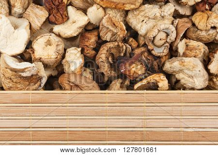 Dried mushrooms and bamboo mat with place for your text