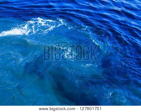 beautiful cloudy blue water flowing and bubbling and splashing splashing splashes drops and spirals and foams