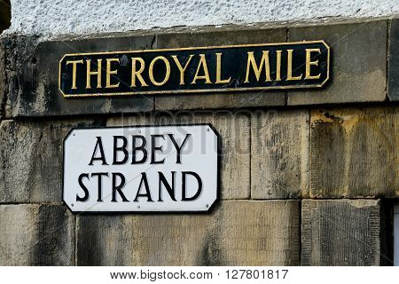 Street sign for the Royal Mile and Abbey Strand in Edinburgh.