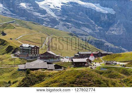 Kleine Scheidegg Switzerland - August 22 2015 -Tourists at the train station of Kleine Scheidegg the transfer station of Jungfrau Railway to the famous Jungfraujoch Swituerland.