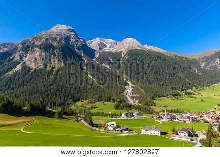 Beautiful view of the small town Bergun and the alps including Piz Ela from the sightseeing train Bernina Express in summer Canton of Grisons Switzerland