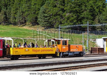 Celerina Switzerland - August 29 2015 - Tourists taking the panoramic sightseeing train of Rhaetian Railway in Grisons travel on the Glacier Express line Switzerland.