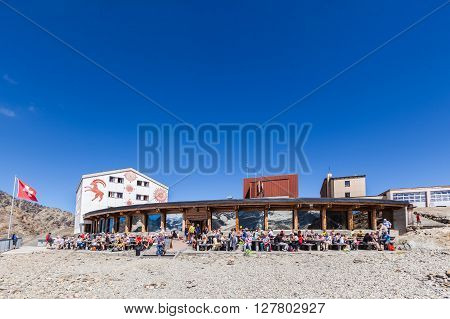 Diavolezza Switzerland - August 29 2015 - People taking rest at the Mountain house Diavolezza in front of the Bernina Massiv and Morteratsch glacier canton of Grisons.