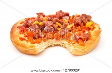 pizza with meat maize and carrot with a bite on white background