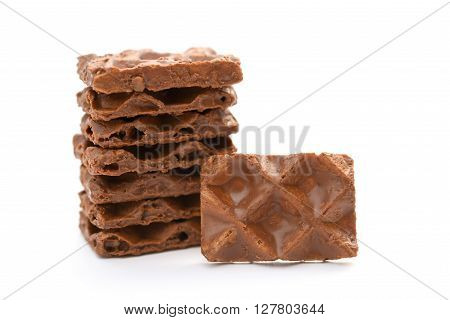 chocolate blocks stack up on a white background