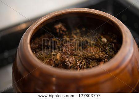 medicinal herbs in enamel pot close up