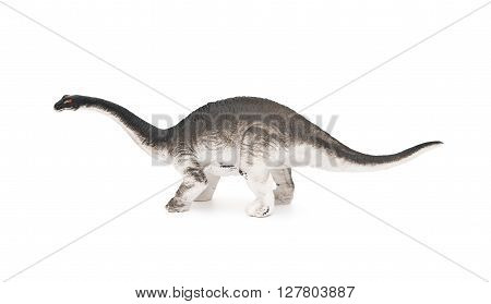 side view grey brachiosaurus toy on a white background