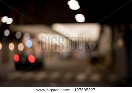 Blurred / Defocussed abstract background of hotel entrance with lights and Taxi Taillight taken in Japan