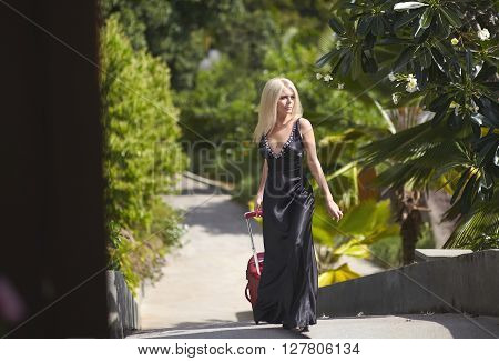 Beautiful, Lovely, Sexual Girl Walking With Luggage Bag To Hotel Room.