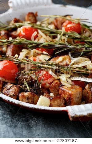 Roast Pork Meat With Rosemary, Tomato And Onion On Frying Pan