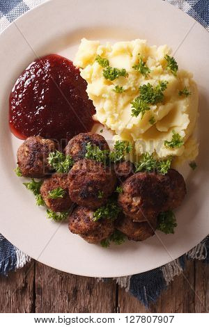 Swedish Cuisine: Meatballs, Lingonberry Sauce, Potato Closeup. Vertical Top View