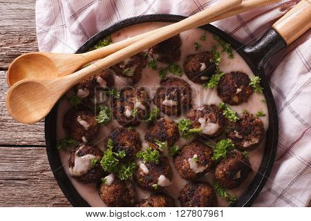 Meatballs With Creamy Berry Sauce Closeup On A Frying Pan. Horizontal Top View