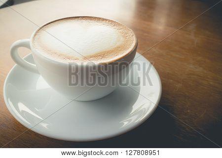 hot coffee with foam milk art of love(vintage effect)