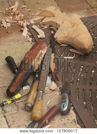 Tools lay ready to finish the work of a carver in a market in Falmouth Jamacia