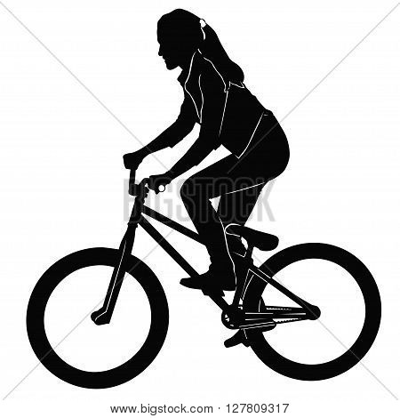 Girl riding a bicycle in black and white